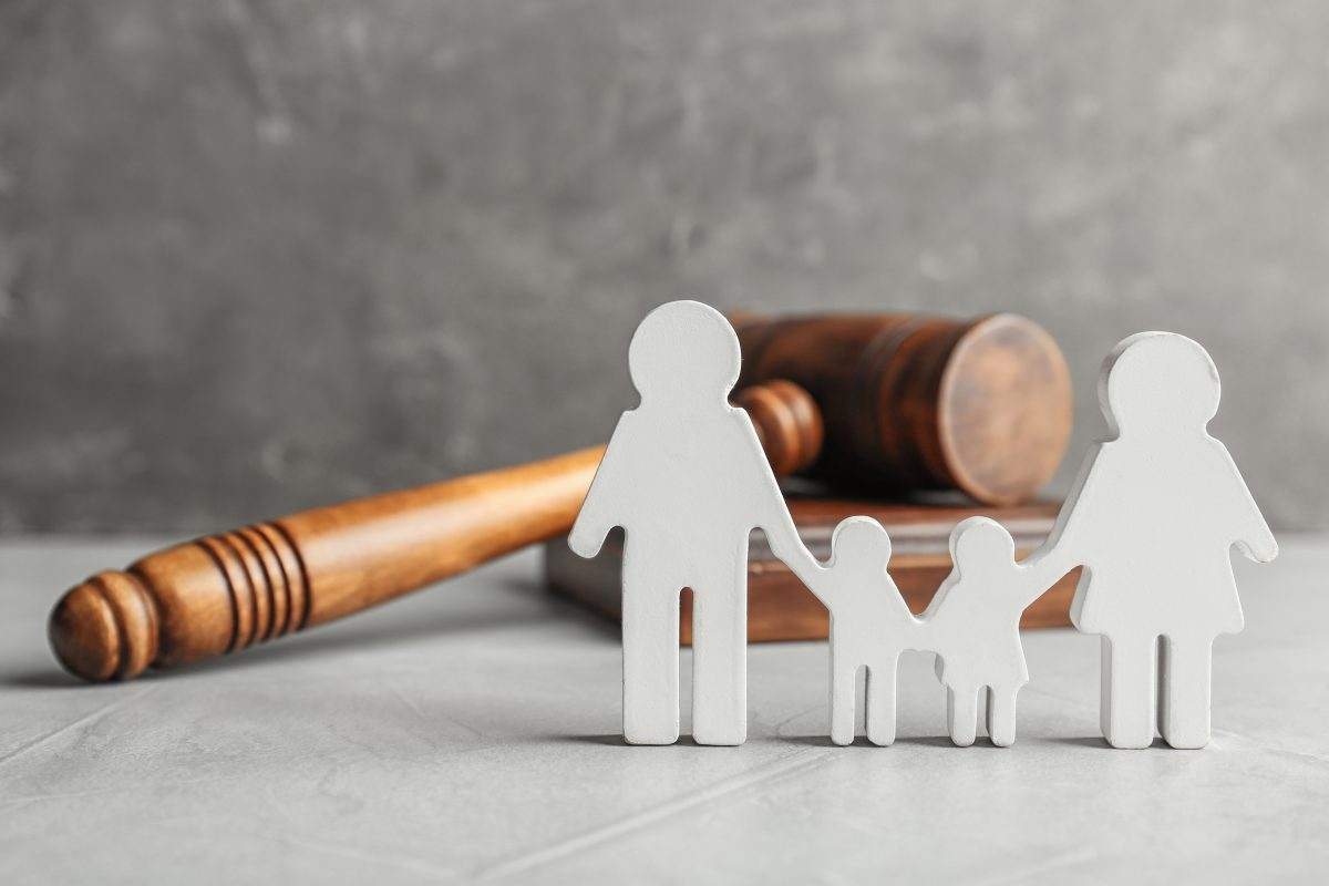 Family,Figure,And,Gavel,On,Table.,Family,Law,Concept